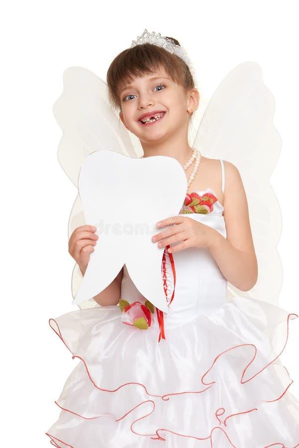 Ząb czarodziejki dziewczyna ubierał w bielu z skrzydłami zdjęcia royalty free
