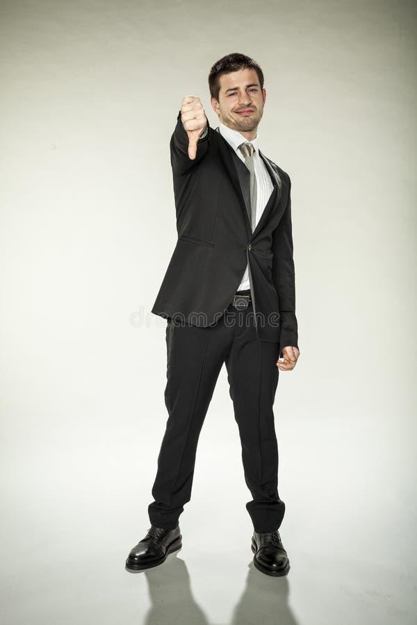 Zła decyzja, kciuka puszek od przystojnego biznesowego mężczyzna obrazy stock