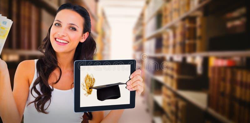 Złożony wizerunek ładna brunetka używać pastylka komputer osobistego zdjęcie stock
