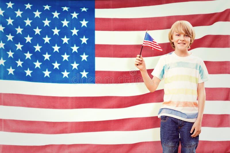 Złożony wizerunek śliczna chłopiec z flaga amerykańską zdjęcia royalty free