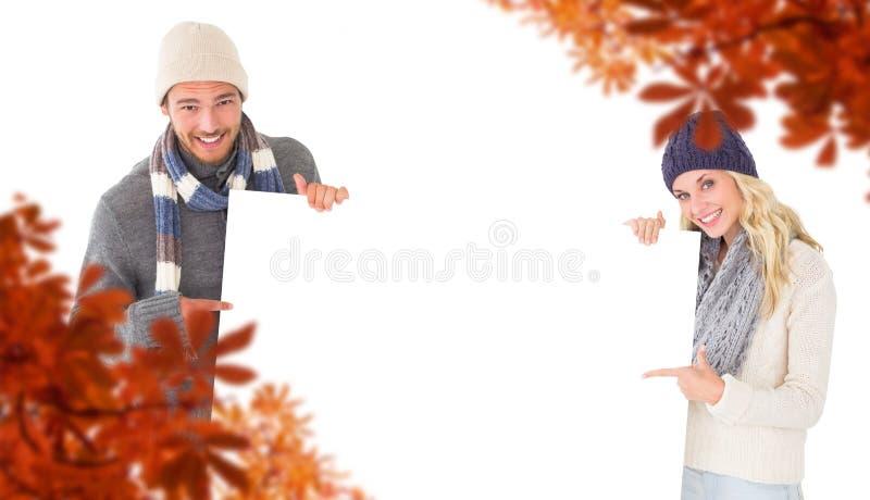 Złożony wizerunek atrakcyjna para w zimy modzie pokazuje plakat fotografia stock