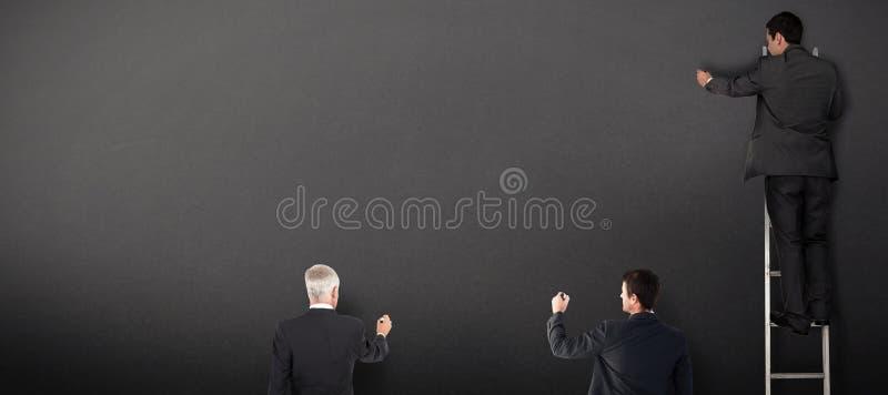 Złożony wizerunek biznes drużyny writing obrazy royalty free