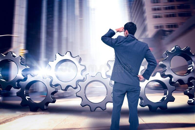 Złożony wizerunek biznesmen pozyci ręka na biodrze zdjęcia royalty free