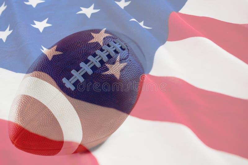 Złożony wizerunek brązu futbol amerykański przeciw białemu tłu fotografia stock