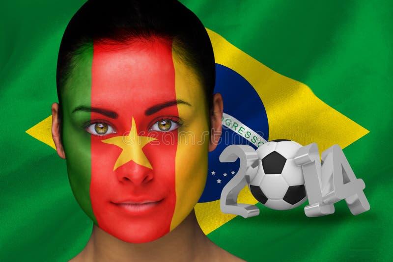 Złożony wizerunek Cameroon fan piłki nożnej w twarzy farbie obrazy royalty free