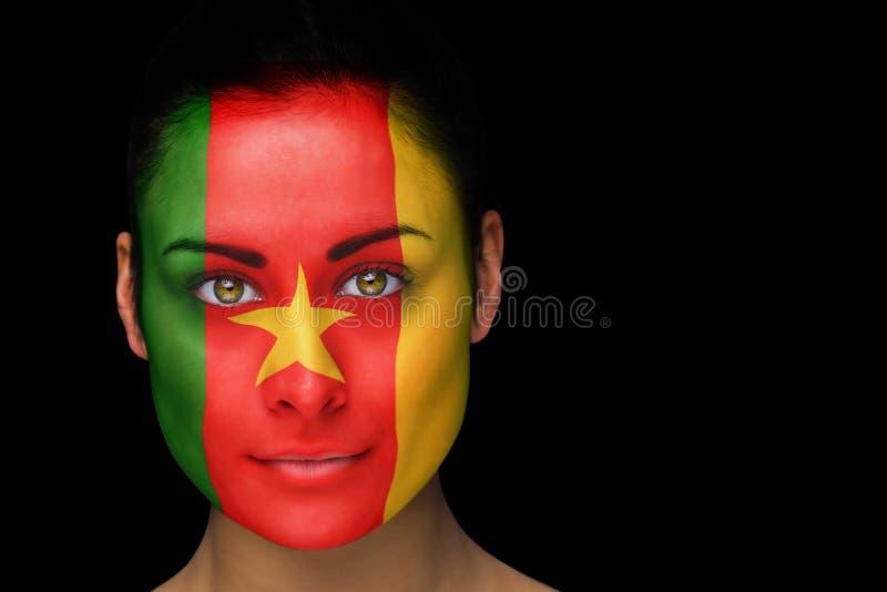 Złożony wizerunek Cameroon fan piłki nożnej w twarzy farbie zdjęcie royalty free