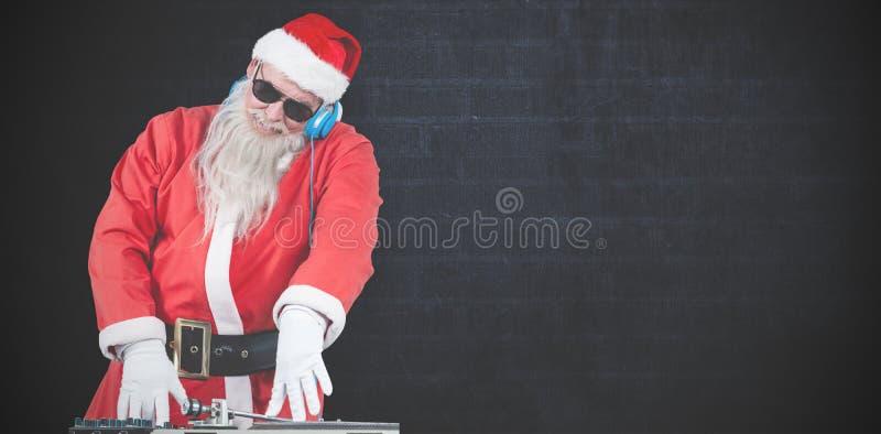 Złożony wizerunek dj Santa Claus miesza dźwięka zdjęcia stock
