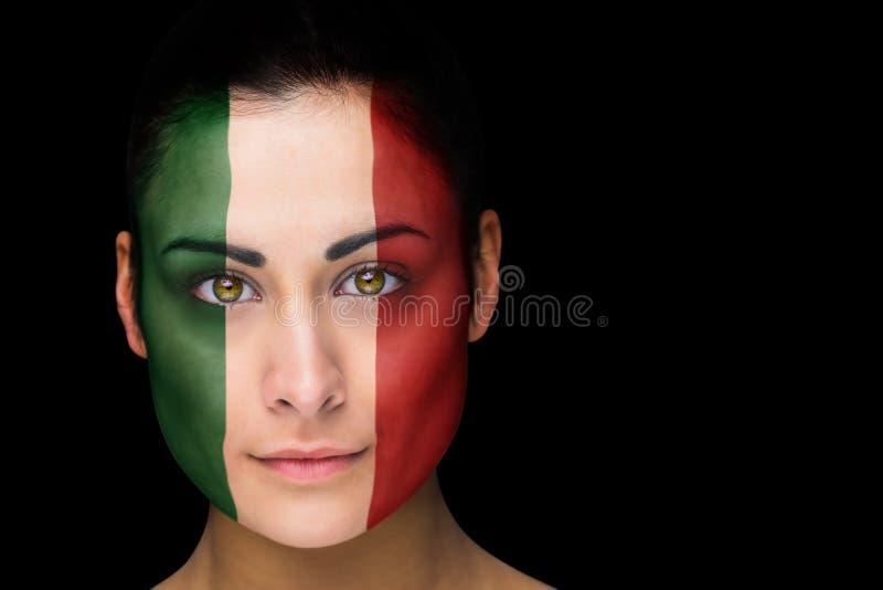 Złożony wizerunek Italy fan piłki nożnej w twarzy farbie obraz stock