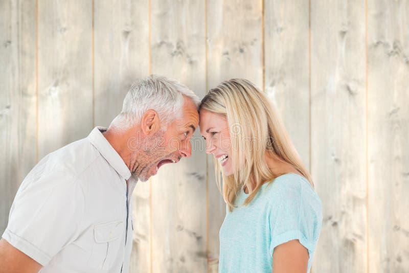 Złożony wizerunek nieszczęśliwa para ma argument obrazy royalty free
