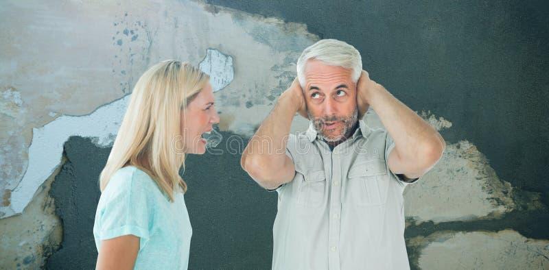 Złożony wizerunek nieszczęśliwa para ma argument z mężczyzna no słucha obraz royalty free