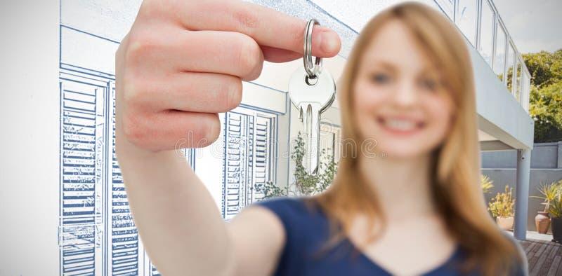Złożony wizerunek ostrość strzał na kobiecie trzyma klucz zdjęcia royalty free