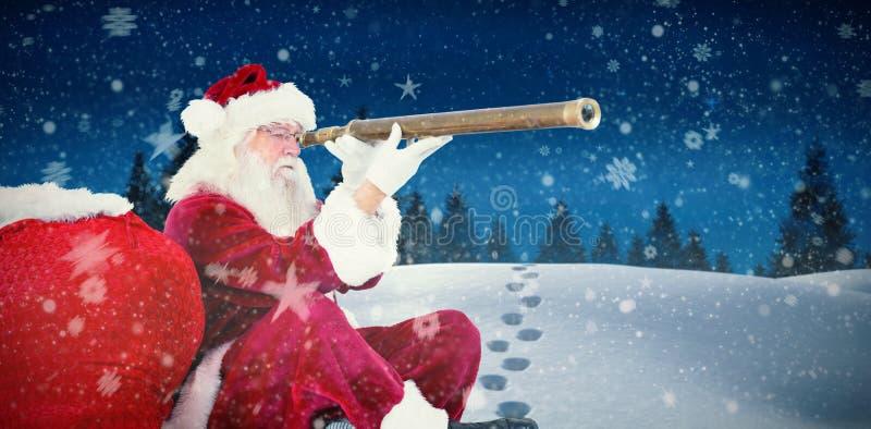 Złożony wizerunek patrzeje przez teleskopu Santa Claus obrazy royalty free