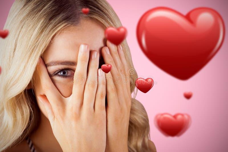 Złożony wizerunek piękna blondynki kobieta chuje za rękami obrazy stock