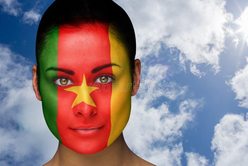 Złożony wizerunek piękna brunetka w Cameroon facepaint fotografia stock