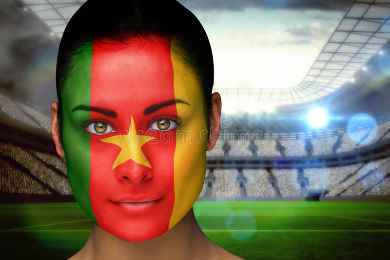 Złożony wizerunek piękny Cameroon fan w twarzy farbie fotografia stock