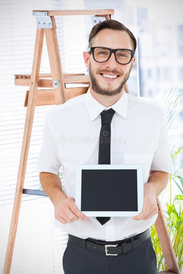 Złożony wizerunek pokazuje jego pastylka komputer osobistego geeky biznesmen zdjęcia royalty free