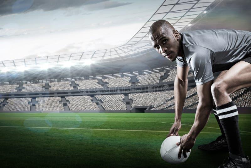 Złożony wizerunek portret rugby gracza mienia piłka zdjęcie royalty free