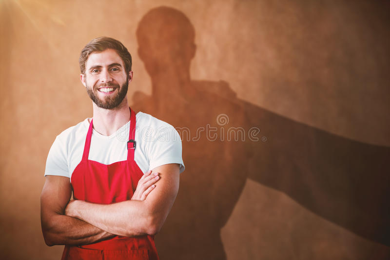 Złożony wizerunek portret uśmiechnięty ufny męski właściciel z rękami krzyżować zdjęcie stock
