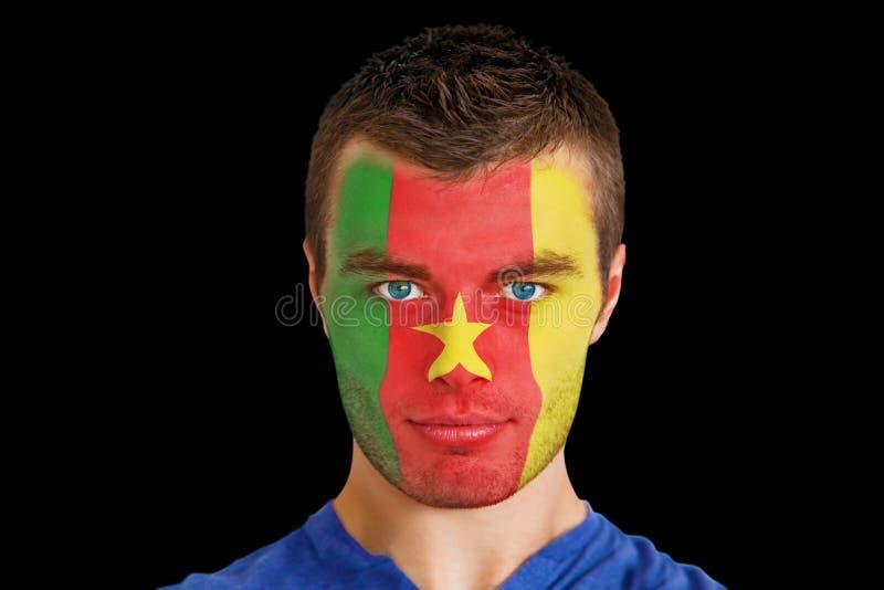Złożony wizerunek poważny młody Cameroon fan z facepaint fotografia stock