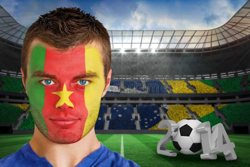 Złożony wizerunek poważny młody Cameroon fan z twarzy farbą fotografia royalty free