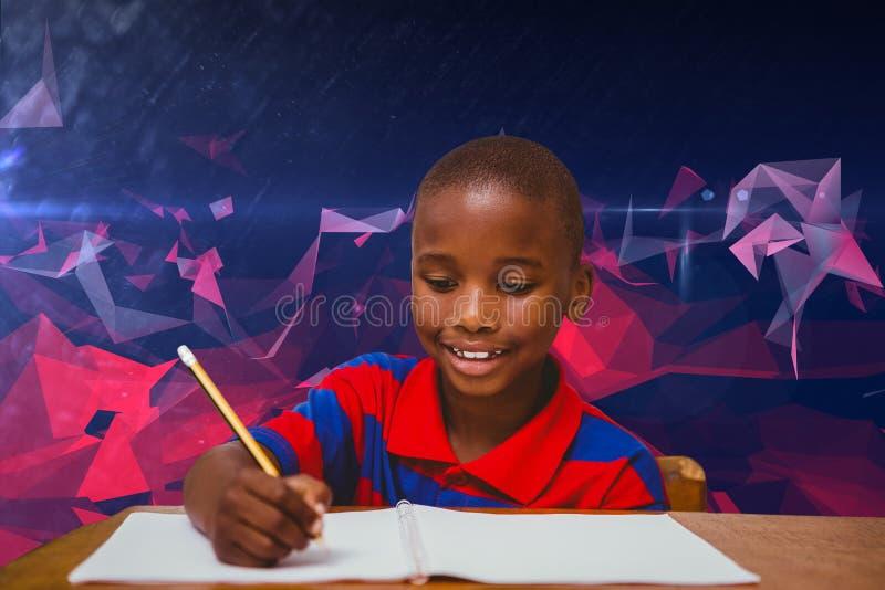 Złożony wizerunek pracuje przy biurkiem uczeń zdjęcia stock