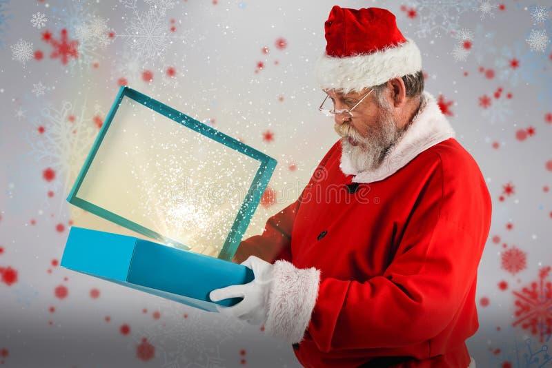 Złożony wizerunek Santa Claus otwarcia prezenta pudełko zdjęcie stock