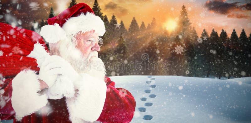 Złożony wizerunek Santa Claus przewożenia worek obraz stock