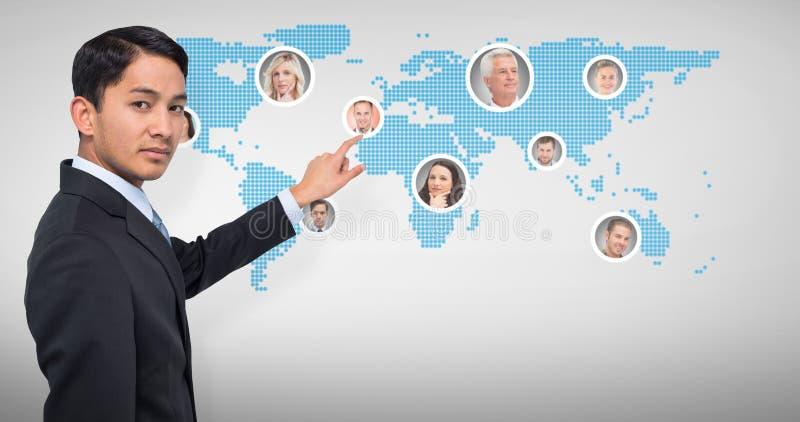 Złożony wizerunek srogo azjatykci biznesmena wskazywać fotografia royalty free