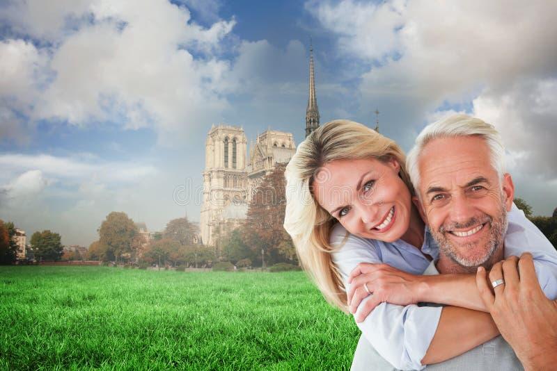 Złożony wizerunek szczęśliwa pary pozycja, przytulenie i fotografia stock