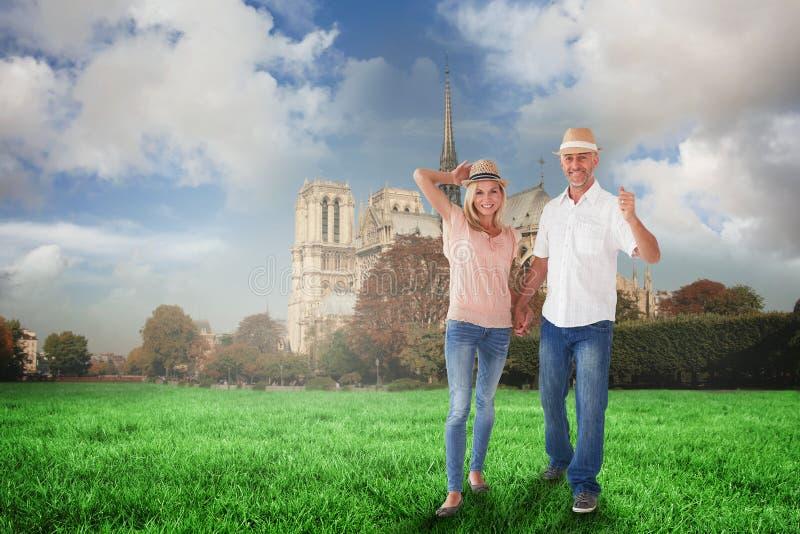 Złożony wizerunek szczęśliwej pary mienia chodzące ręki obraz stock