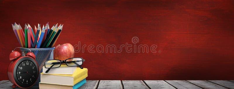 Złożony wizerunek szkolne dostawy na biurku royalty ilustracja