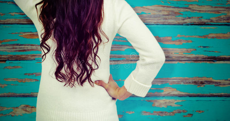 Złożony wizerunek tylni widok zmieszana kobieta z ręką w włosy zdjęcia royalty free