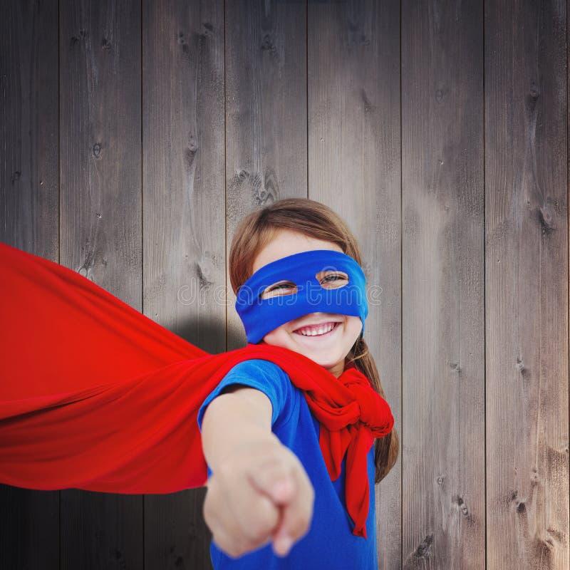 Złożony wizerunek uśmiechać się zamaskowanej dziewczyny udaje być bohaterem obraz royalty free