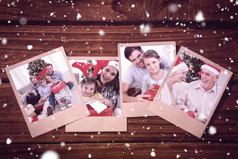 Złożony wizerunek uśmiechnięta mała dziewczynka z jej ojcem trzyma boże narodzenie prezent obraz stock
