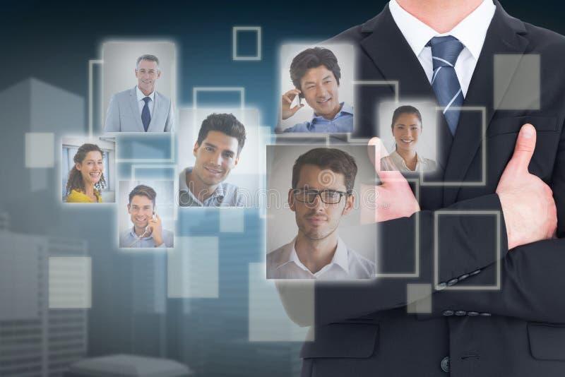 Złożony wizerunek w połowie sekcja biznesmen z rękami krzyżować obraz stock