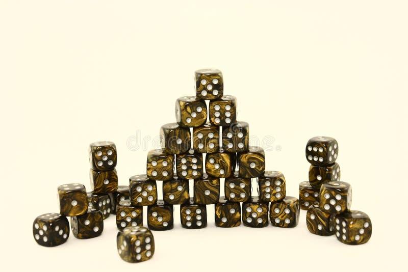 złociści czarny kostka do gry obrazy stock