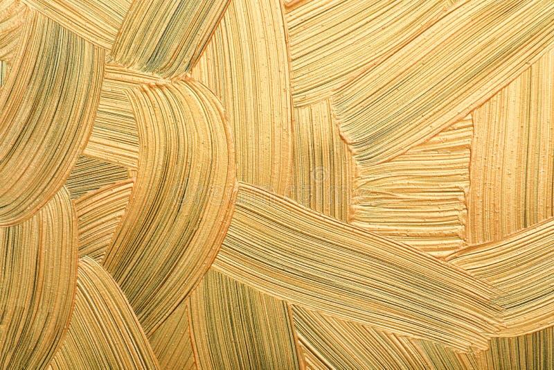 Złoci farby muśnięcia uderzenia jako tło zdjęcie royalty free