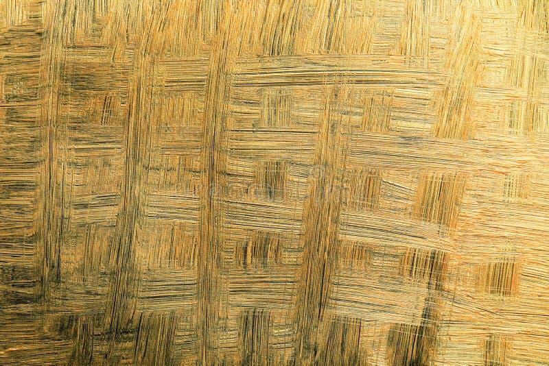 Złoci farby muśnięcia uderzenia jako tło obrazy royalty free