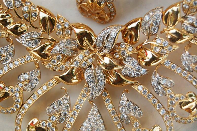 Złoci kolia liście, szczegół zdjęcia royalty free