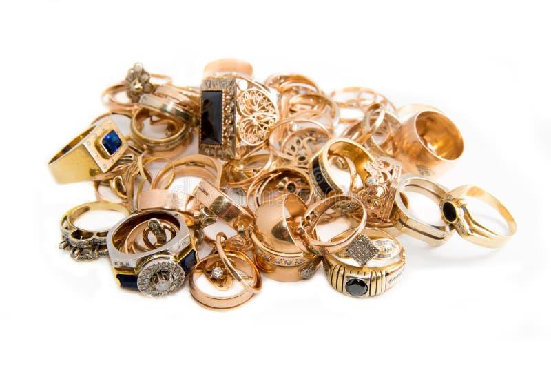 złocista biżuteria odizolowywająca na bielu fotografia stock