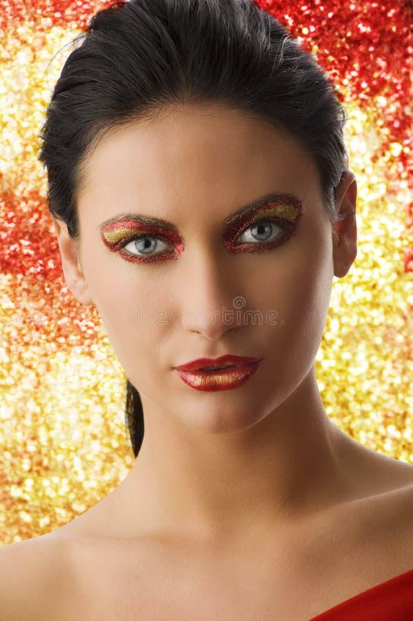 złocista czerwona kobieta fotografia royalty free