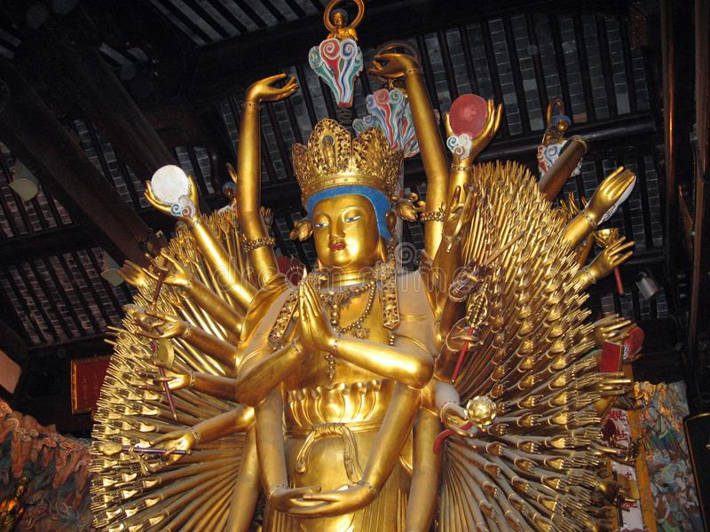 złocista Hinduska bogini statua z wieloskładnikowymi rękami obrazy stock