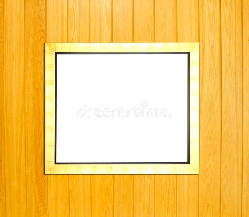 Złocista rocznika obrazka rama na drewnianym tle obraz royalty free