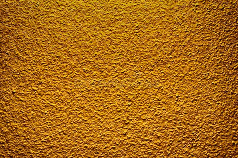 Złocistej kolor betonowej ściany farby tekstury abstrakcjonistyczny tło obraz stock