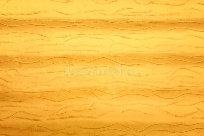 Złocisty betonowej ściany tło, natura wzory w linii z koszową teksturą obrazy royalty free