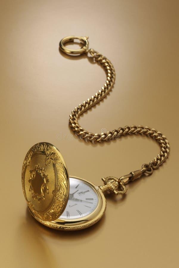 Złocisty kieszeniowy zegarek fotografia royalty free