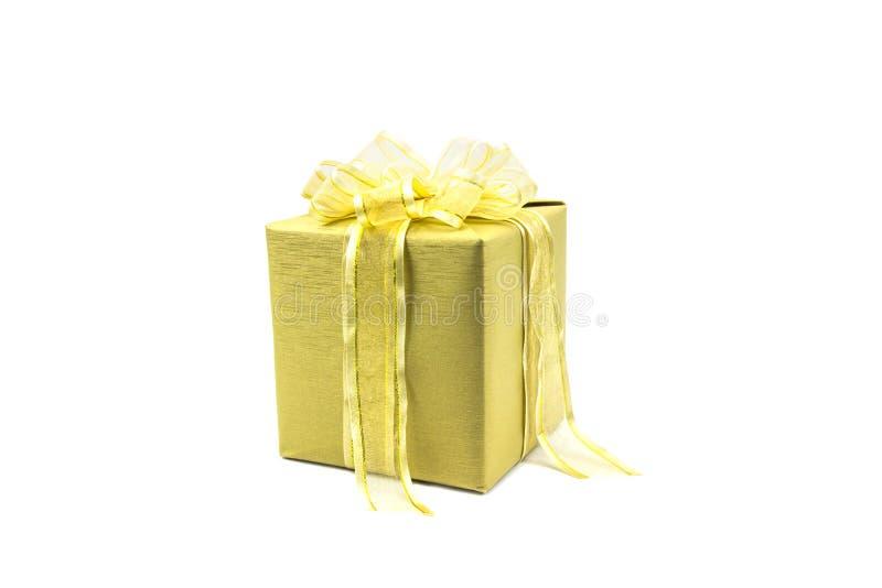 Złocisty prezenta pudełko, faborek odizolowywający na białym tle i zdjęcie stock
