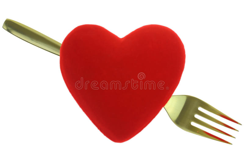 Złocisty rozwidlenie za czerwonym sercem zdjęcie royalty free