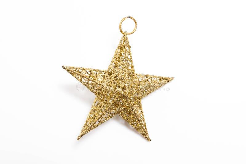 Złota gwiazda dla dekorującej choinki fotografia royalty free