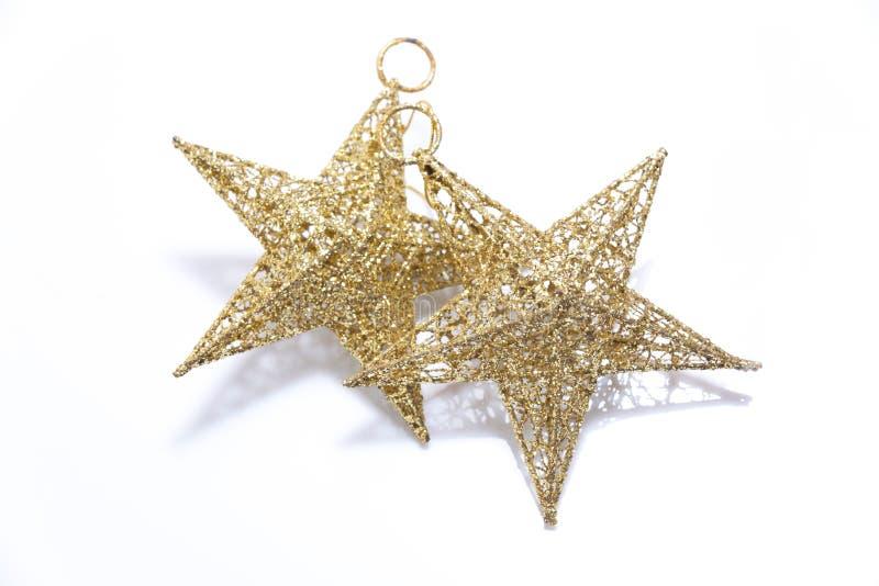 Złota gwiazda dla dekorującej choinki obraz royalty free